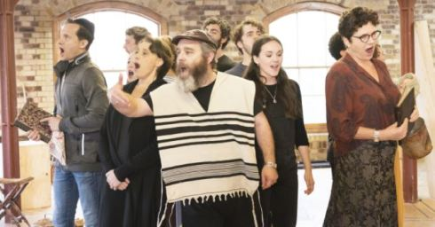 The company of Fiddler on the Roof in rehearsal.