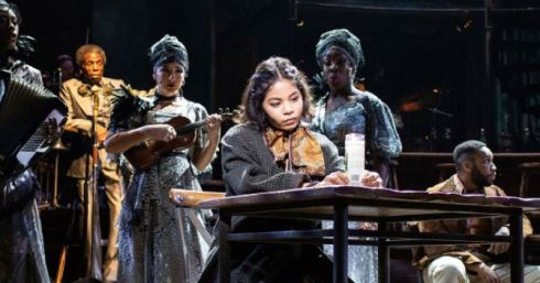 Eva Noblezada,  Andre De Shields with  Carly Mercedes Dyer, Rosie Fletcher and Gloria Onitiri as The Fates. Photo by Helen Maybanks.